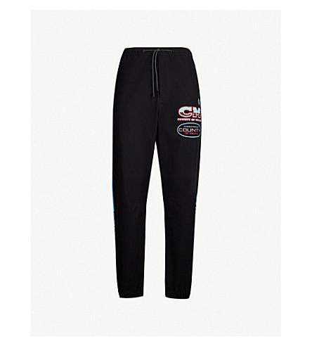 MARCELO BURLON 徽标打印软壳面料慢跑裤 (黑色 + 多色