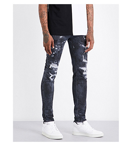 MARCELO BURLON Distressed slim-fit tapered mid-rise jeans (Tie+dye+no+colour