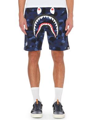 A BATHING APE Camouflage shark-motif cotton shorts