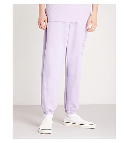 BORN X RAISED Logo-print cotton-jersey jogging bottoms (Lavender