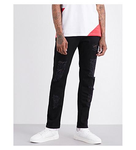 VERSACE VERSUS Distressed slim-fit tapered jeans (Black