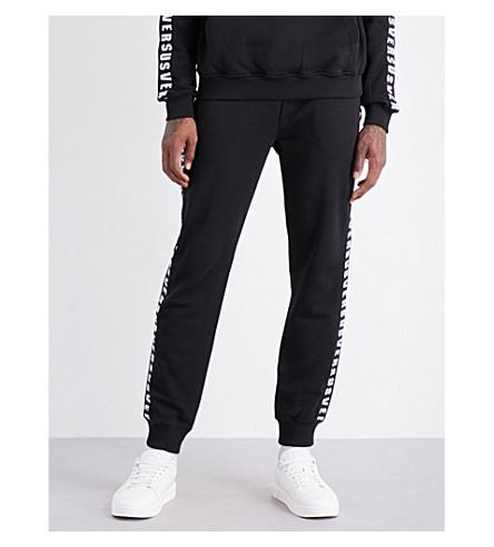 VERSACE VERSUS Logo-print cotton-jersey track pants (Black