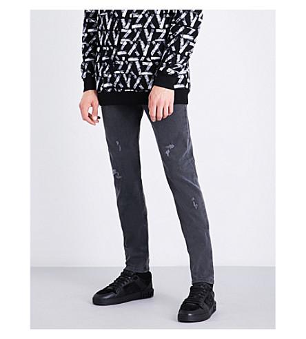 VERSACE VERSUS Versus x Zayn distressed skinny mid-rise jeans (Grey+denim