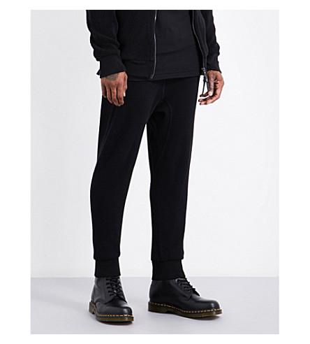 11 BY BORIS BIDJAN SABERI Waffle-knit high-rise cotton jogging bottoms (Black+dye