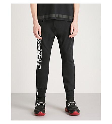 UNRAVEL Tour cotton-jersey jogging bottoms (Black+white
