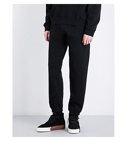 ADIDAS X ALEXANDER WANG Logo-embroidered fleece-panel cotton-jersey jogging bottoms (Black