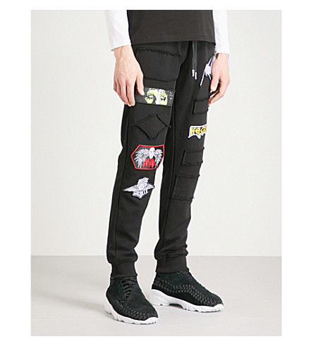 HACULLA Mad Max appliqué cotton-jersey jogging bottoms (Black