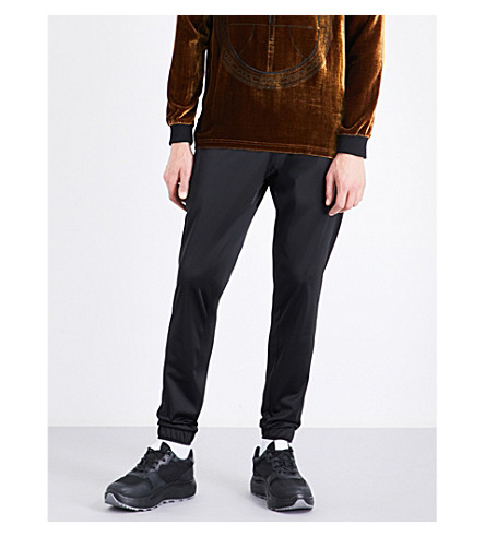 ASTRID ANDERSEN Classic tapered shell jogging bottoms (Black+jersey