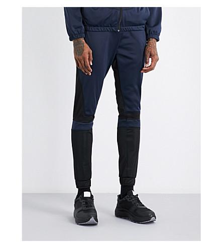 ASTRID ANDERSEN Panelled shell jogging bottoms (Navy+black