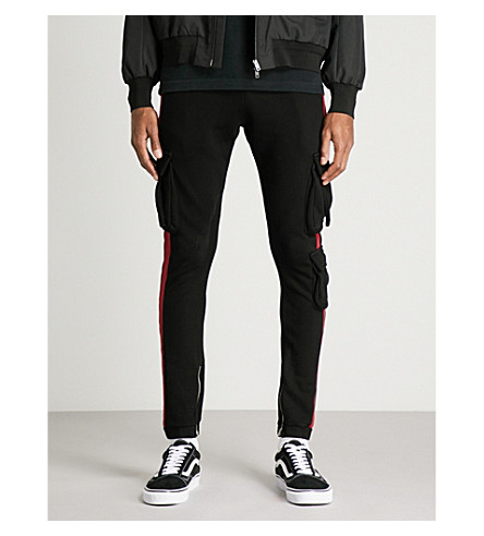 PROFOUND AESTHETIC Striped-panel slim-fit cotton-jersey jogging bottoms (Black+red