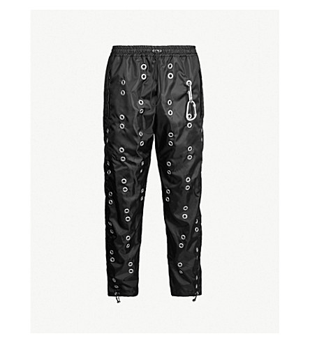 STUDIO ALCH Eyelet-embellished shell track pants (Black