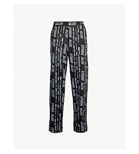 STUDIO ALCH Logo-print regular-fit tapered drill pants (Black white