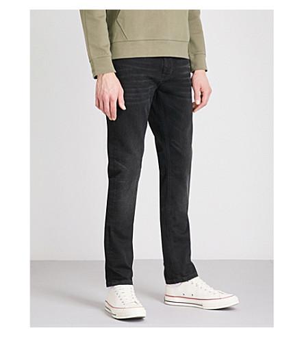NUDIE JEANS Lean Dean slim-fit tapered jeans (Black+star