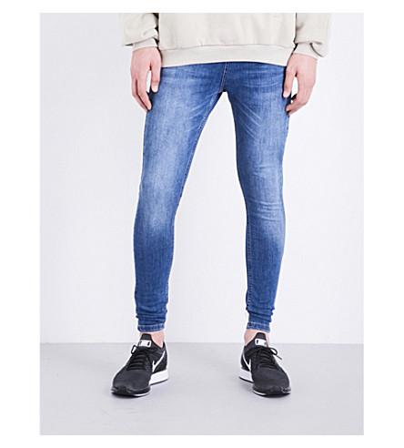 HERA Ripped spray-on skinny jeans (Dk blue