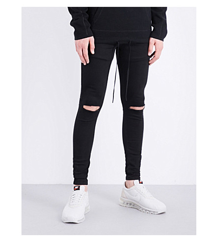HERA Ripped Knee spray-on skinny jeans (Black