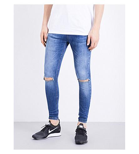 HERA Ripped Knee spray-on skinny jeans (Dk blue