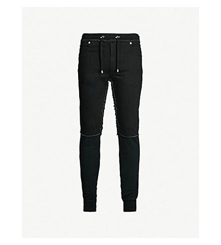 BALMAIN Slim-fit denim and jersey jogging bottoms (Noir
