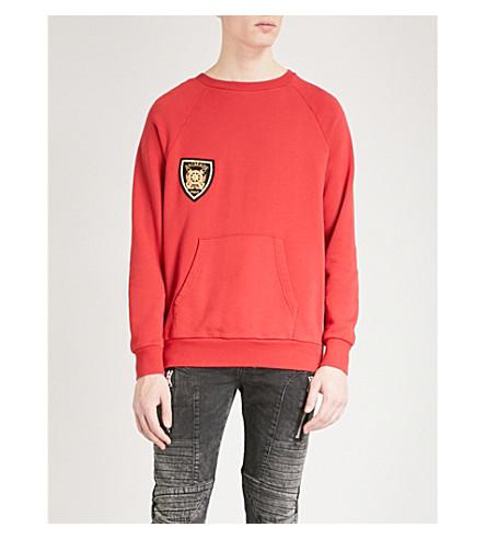 BALMAIN Badge-detail cotton-jersey sweatshirt (Rouge