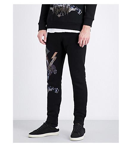 BALMAIN Graphic-print cotton-jersey jogging bottoms (Black
