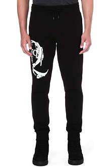 MCQ ALEXANDER MCQUEEN Scratched logo jogging bottoms