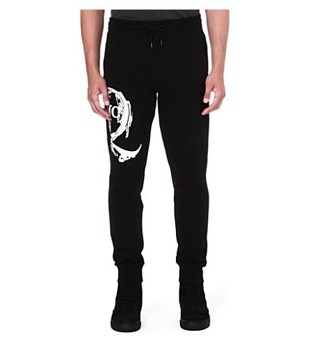 MCQ ALEXANDER MCQUEEN Scratched logo jogging bottoms (Black