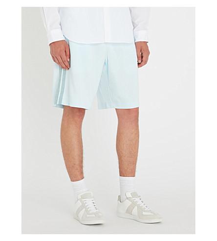 COMME DES GARCONS HOMME PLUS Side-stripe jersey shorts (Blue