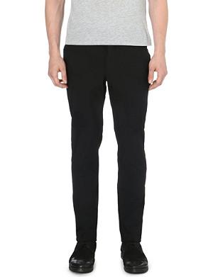 COMME DES GARCONS Crinkled-effect polka-dot trousers
