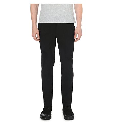 COMME DES GARCONS Crinkled-effect polka-dot trousers (Black