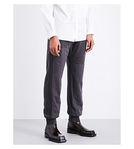 HAIDER ACKERMANN Relaxed-fit skinny mid-rise cotton-jersey jogging bottoms (Anthracite