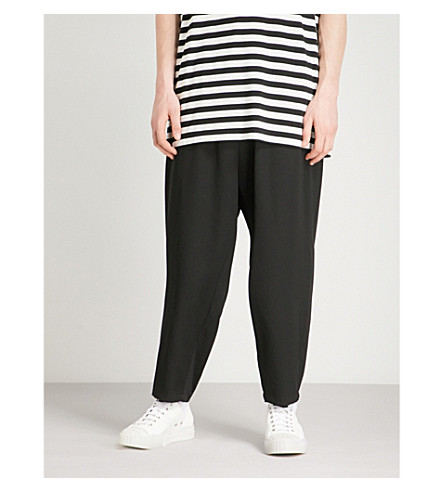 YOHJI YAMAMOTO Relaxed-fit tapered wool trousers (Black