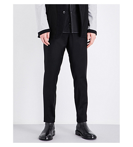 ANN DEMEULEMEESTER Drawstring-tie tapered regular-fit wool trousers (Black