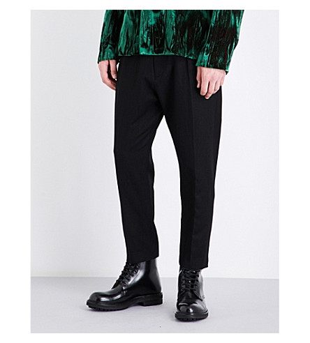 ANN DEMEULEMEESTER Dropped-crotch tapered regular-fit wool trousers (Black