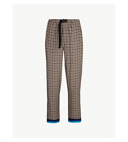 DRIES VAN NOTEN Geometric-print regular-fit straight jersey trousers (Brown