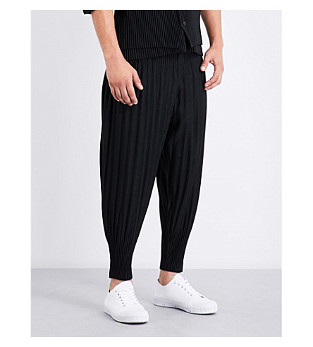 HOMME PLISSE ISSEY MIYAKE Dropped-crotch pleated trousers (Black