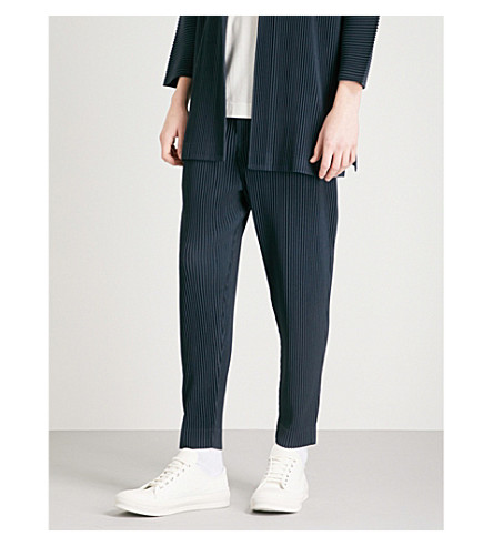 HOMME PLISSE ISSEY MIYAKE Relaxed-fit tapered pleated crepe trousers (Midnight+blue