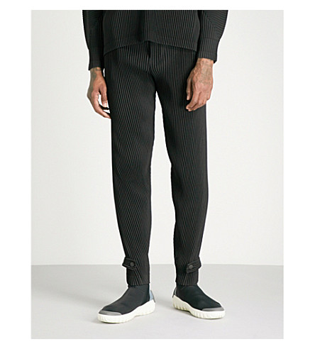 HOMME PLISSE ISSEY MIYAKE Relaxed-fit skinny pleated trousers (Black