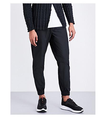 ISSEY MIYAKE Textured woven jogging bottoms (Black