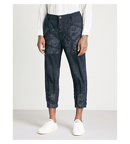 ISSEY MIYAKE Printed relaxed-fit cotton-blend trousers (Navy