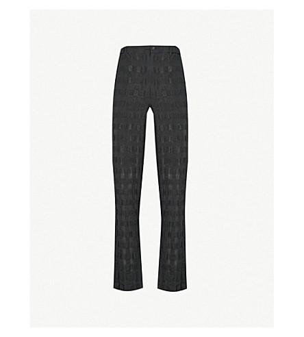 ISSEY MIYAKE Seersucker linen and cotton-blend Trousers (Black