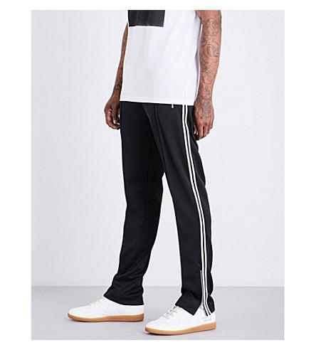 MAISON MARGIELA Contrast-trim relaxed-fit mid-rise cotton-jersey jogging bottoms (Black