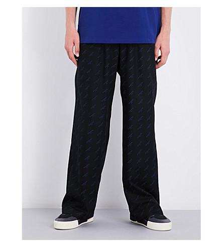 BALENCIAGA Logo-print relaxed-fit straight cotton trousers (Noir+pacifique