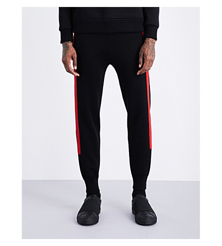 NEIL BARRETT Contrast-stripe waffle-knit low-rise wool jogging bottoms (Black+red