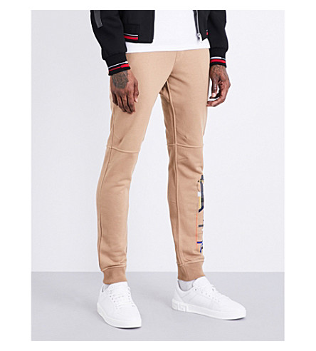 VERSACE Logo-print relaxed-fit mid-rise cotton-jersey jogging bottoms (Camel