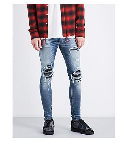 AMIRI Leather patch slim-fit skinny jeans (Medium+indigo+tint
