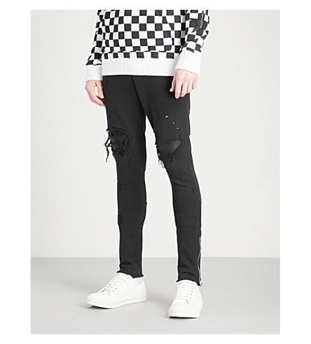 AMIRI MX1 distressed cotton-jersey jogging bottoms (Black