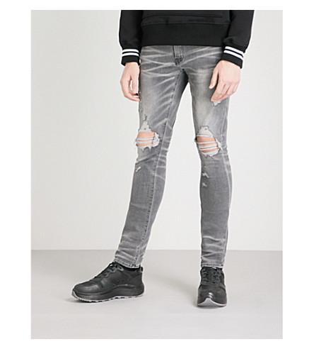 AMIRI Thrasher slim-fit skinny jeans (Light+grey