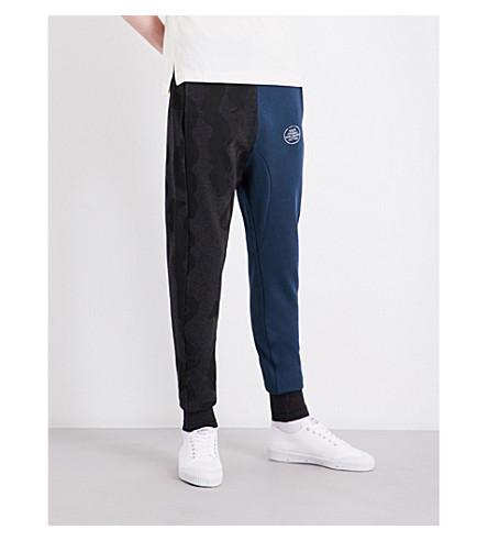 VIVIENNE WESTWOOD Dual-print cotton-jersey jogging bottoms (Mix+black+print