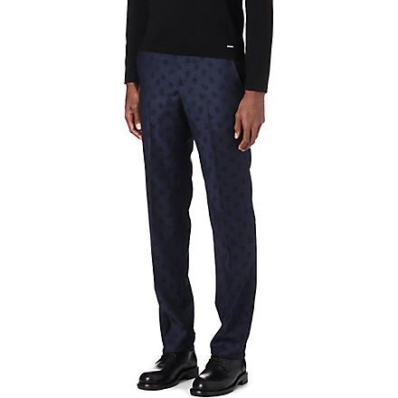 ALEXANDER MCQUEEN Slim-fit skull trousers (Navy