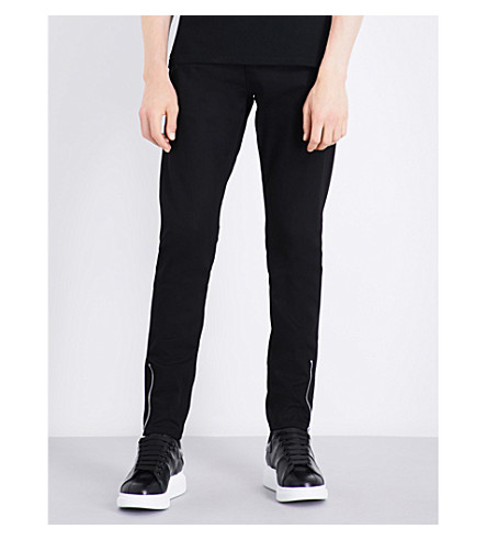 ALEXANDER MCQUEEN Zipped-cuffs slim-fit tapered jeans (Black/black