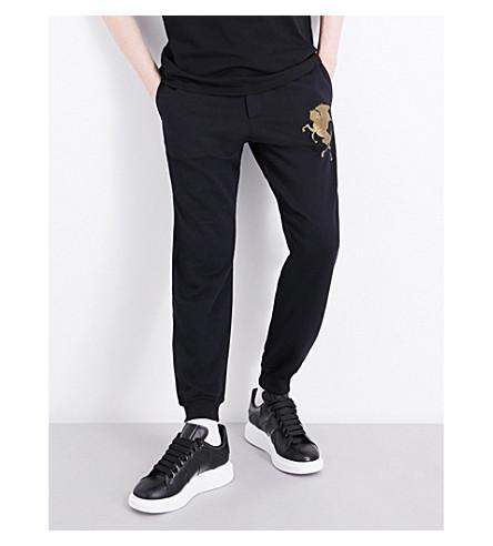 ALEXANDER MCQUEEN Metallic animal-embroidered cotton track pants (Black